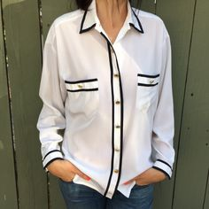 Chanel silk blend button down! Beautiful authentic Chanel silk blend button down with black trim and gold cc hardware. Size medium. Maybe worn once. Excellent condition. Arm length 20.5 in. Length 26.5 in. Chest 21 in. Shoulder to shoulder (drop style) 19.5 in. Bundle and save! CHANEL Tops Button Down Shirts
