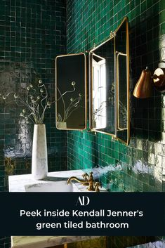 """I like a house that has character. When I walked into this place, I was immediately drawn to the peaceful Spanish-y, farmhouse-y vibe."" #mosaic #tile #iridescent #emerald #gold #mirror #marble #brass #vanity #sink #flower #arrangement #lamp #fixtures #copper #sconce #vintage #bathroom Casa Kendall Jenner, Cheap Plants, Teal Kitchen, Kitchen Tile, Pierre Jeanneret, Cozy Fireplace, Los Angeles Homes, Beautiful Villas, Painted Doors"