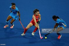 Anuradha Thokchom #10 and Poonam Rani #15 of India defend against Laura Unsworth #4 of Great Britain during a Women's Pool B match on Day 3 of the Rio 2016 Olympic Games at the Olympic Hockey Centre on August 8, 2016 in Rio de Janeiro, Brazil.