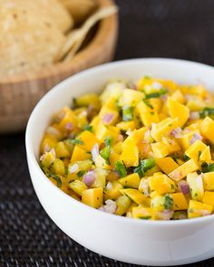 Mango-Pineapple Salsa....OMG!! Can't wait to try this! I love Pampered Chefs Mango Confetti salsa so I am over the top to try this one!