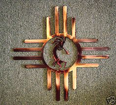 Western Sun Zia metal wall art w/ Kokopelli, OK outside