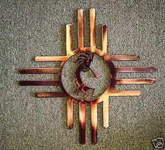 Western Sun Zia metal wall art w/ Kokopelli, OK outside
