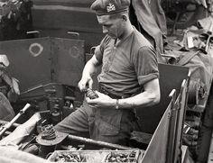 A soldier fuses a hand grenade, England, June 1944. LIEUT. FRANK L. DUBERVILL, LIBRARY AND ARCHIVES CANADA—PA191017