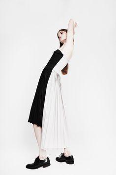 Contemporary Fashion - black & white dress with high low hem & sleek pleats // Youjia Jin Spring 2016