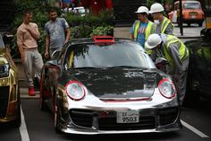 Builders admire a Kuwaiti-registered Porsche 997 on July 2015 in London, England. London has become known in recent years for a proliferation of foreign cars worth hundreds of thousands of. Get premium, high resolution news photos at Getty Images Customize My Car, Miniature Cars, Car Museum, Porsche 911, My Dream, Super Cars, In This Moment, History, Vehicles