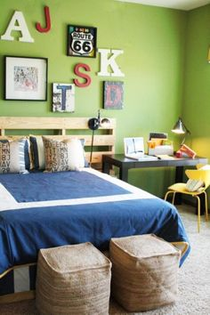 Give a boy's bedroom a nautical vibe with a navy boy's bedroom ideas set, plank walls, and ship-inspired accessories. A gallery wall of antique posters and sailboat flag bunting adds to the theme without making the decor look too juvenile. A madras quilt at the foot of the bed brings all the accent colors together.