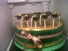 """My burst of creativity for Haylee's graduation party. Chocolate graduation caps (reese's miniature pb cups with a square of Ghiradelli chocolate on top with thinly cut """"sour belt candy"""" attached with warm chocolate, topped with a drop of frosting and put on a lollipop stick---stuck in a styrofoam form, decorated in Haylee's school colors. Cool, right?"""