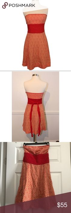 Free People red and orange strapless dress Free People red and orange floral strapless dress. Size 8 and ties in the back. Free People Dresses Strapless