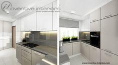 Projekt kuchni Inventive Interiors - beżowe i białe szafki w kuchni, szary blat i szare szkło na ścianie - jasna aranżacja wąskiej kuchni