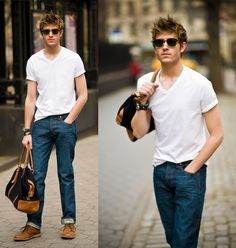 Mention @lookastic in a comment to a pin to make it shoppable. Shop this look for $186:  http://lookastic.com/men/looks/sunglasses-and-v-neck-t-shirt-and-jeans-and-holdall-and-desert-boots/2789  — Black Sunglasses  — White V-neck T-shirt  — Navy Jeans  — Black Canvas Holdall  — Walnut Suede Desert Boots