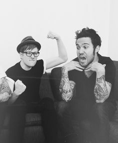 Patrick Stump (being a cute little nerd) and Pete Wentz (being adorable)