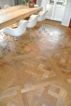 wood floor + Vitra chairs, classic and modern combined, houten vloer www.versaillesparket.nl