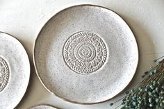 "Hand formed Stoneware Dinnerware Plates set of 4, hand painted in a Speckled White Glossy glaze. The outside of these plates are left unglazed. Each plate is unique and has a organic shape from the hand building process. The set includes: 1 Dinner plate : 10"" 1 Salad Plate : 9"" 1 Dessert Plate: 6.5"" 1 small side plate: 5""x 5.5"" Lead free Food, Dishwasher, microwave safe"