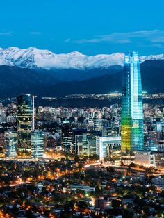 Santiago, Chile: The city is the political hotbed and the commercial center of Chile. The capital city destination Santiago enjoys the influx of tourists for its modern high-rises and stunning views, shopping experiences to shop til you drop while museums for history and restaurants for foodies. #Santiago #GranTorreSantiago #TitaniumLaPortada #Skyscraper #AndesMountain #Providencia #Chile #SouthAmerica #FlightstoSantiago #TravelCenter #AirfaresMarketLeader