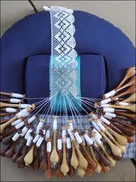 Bobbin lace in process.