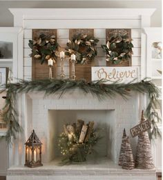love the wood with fir branches and lights in the fireplace christmasholidaydiydecor - Farmhouse Christmas Decor Pinterest