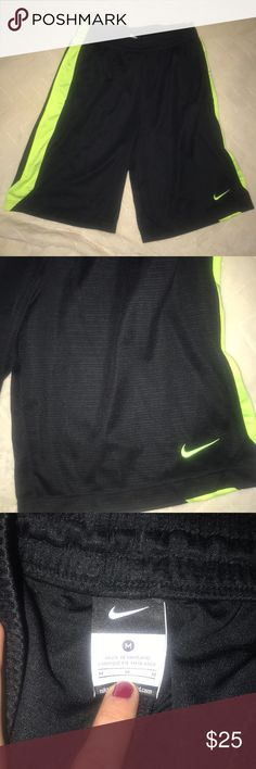 Nike men's basketball shorts brand new Black Nike shorts with a bright yellow side stripe Nike Shorts Athletic