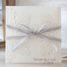 Entwine Embossed Laser Cut Range  Laser cut wedding invitations perfect for your luxury wedding. DIY laser cuts are easy and elegant with options to insert your own printer inserts.