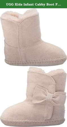 """UGG Kids Infant Cabby Boot Freshwater Pearl Size 2-3 M US Infant. Hook-and-loop closure. Warm sheepskin lining. UGGpureâ""""¢ wool insole. Suede and rubber outsole. Imported. This product contains real fur from sheep or lamb.Fur origin: Australia, Ireland, United Kingdom, or United StatesReal fur has been artificially dyed and."""