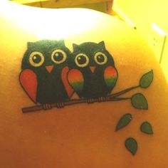My owl tattoo for my son. Mama owl & baby owl. I chose the rainbow colors for the baby owl because my son is on the Autism Spectrum..