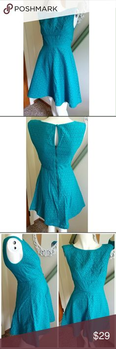 """Ann Taylor Loft Dress Gently worn. Eyelet pattern. No rips to eyelet pattern. Lined. Zipper in back with key hole. Fit and flare silhouette. Design to fall above knee. 100% cotton. Measurements Length 32"""" ; bust 33"""" ; waist 25.5"""" ; hips 35.5"""" color harbor teal. LOFT Dresses"""