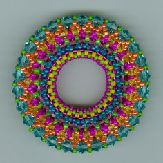 """This is my version of  """" The Sun """" wheel with all the colors of the rainbow.  Made by Marcie Lynne"""