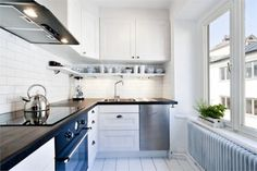 White subway tiles, white cupboards and wooden benchtop are the business