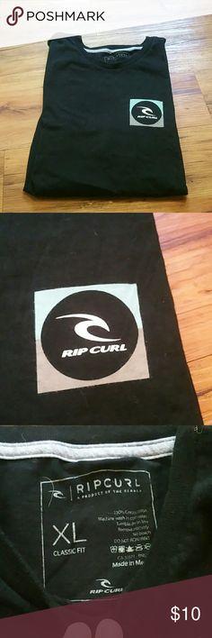 Rip curl xl black tshirt men's surf Rip curl black cotton xl men's logo tshirt Good shape , no holes or markings. Armpit to armpit 23 inches and 30 in length Rip Curl Shirts Tees - Short Sleeve