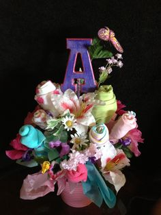 "Diaper cakes for baby showers are out! Now create your own custom made ""Flower bouquet"" made of onesies and wash cloths. Also add cute matching flowers from your local craft store for that final touch. Super affordable and it will definitely stand out from the rest. Under $25"