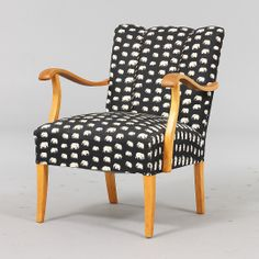 Armchair from the 50s upholstered with newer elephant fabric  – Auctionet