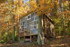 Tiny house in West Virginia uses dozens of reclaimed windows to create window wall. Cabins In West Virginia, Virginia Usa, Reclaimed Windows, Recycled Windows, Reclaimed Lumber, Recycled Wood, Recycled Materials, Glass Cabin, Vie Simple