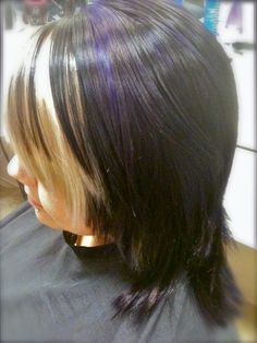 Purple and black hair with blonde bangs