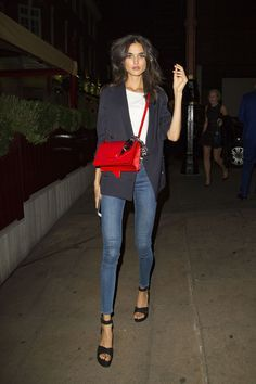 weekend outfit red purse high heels jeans