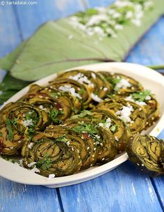 Colcocasia leaves are very nutritious as well as tasty, especially if made intoPatra – a smooth paste of besan with spicy, sweet and sour flavours is applied over the leaves, rolled and steamed. Jain Recipes, Gujarati Recipes, Veg Recipes, Indian Food Recipes, Vegetarian Recipes, Snack Recipes, Cooking Recipes, Recipies, Cooking Tips