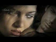 Έσπασε η νύχτα δυο κομμάτια - Αντωνης Ρεμος   ...μα εχθές αργά το βράδυ, δίχως να το φανταστώ, σε συνάντησα στο δρόμο, κι έμεινα να σε κοιτώ..........τον κρατούσες απ'το χέρι, του γελούσες τρυφερά και σταμάτησε ο χρόνος ξαφνικά...........  Έσπασε η νύχτα δυο κομμάτια......... κι έκλεισα σφιχτά τα δυο μου μάτια...... είπα δεν μπορεί όταν τ'ανοίξω...... αυτή η εικόνα θα χαθεί............... Μα που τέτοια τύχη........ :-/