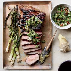 Food & Wine's grilled steak and scallions with fresh ginger is the perfect summer cookout recipe.