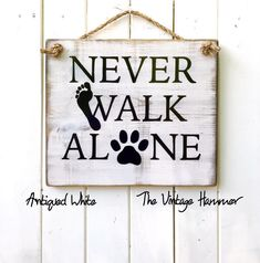Dog parents know that you will NEVER WALK ALONE when you have the love of your dog.  Get this sign today in 16 different color choices!  Exclusively at THE VINTAGE HAMMER ❤️