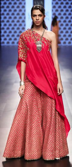 A model displays a one-shoulder red designer lehenga at one of the LFW events. (Image Source: Pinterest)