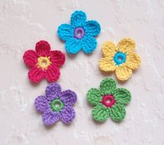 crocheted flowers...if centers are big enough you can use these as button covers