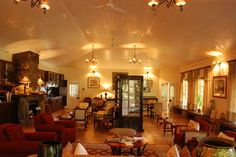 Sit and read in the lounge area, there is a wealth of books and information about the history of Mlilwane and the Reilly family. Lounge Areas, Wealth, Ceiling Lights, Rock, History, Travel, Home Decor, Living Rooms, Historia