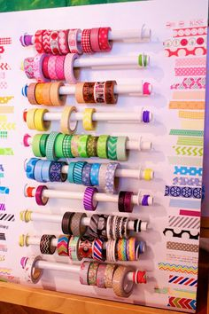 PVC Pipe Washi Tape Organize. Scrap wood, 1/2 inch pvc pipe, hooks. Used peg board to measure  mark holes for hooks.