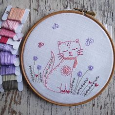 This hand embroidery pattern for a cute little kitten sitting in a garden stitched in my favourite pinks and reds is a downloadable PDF for you to print at home She can either be stitched and then framed in a hoop or stitched and then stuffed with lavender or stuffing and made into a cute
