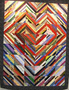 A nice example of a Heartstrings quilt.  nice... I am saving my stipes to make a string quilt..this lay out is nice!!