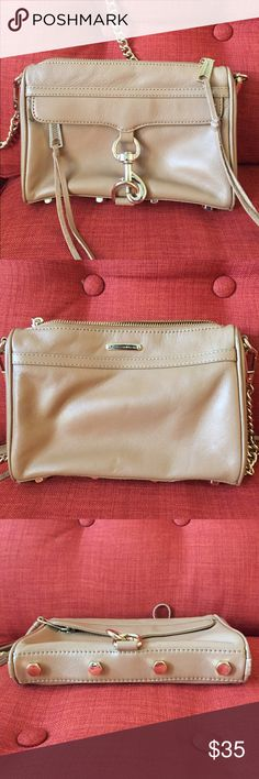 """Rebecca Minkoff Mini MAC Convertible Crossbody Bag Used. Has 3 small areas of black ink marks as shown in picture. Description as taken from Nordstrom site: """"An oversized clip-lock gleams at the front flap of a rich leather crossbody, while an optional chain strap lets you switch in a flash from handheld to over-the-shoulder style. Top zip closure. Exterior zip pocket under flap. Interior wall pocket. Protective metal feet. Signature print lining. Leather. 9""""W x 6 ½""""H x 1 ½""""D. (Interior…"""
