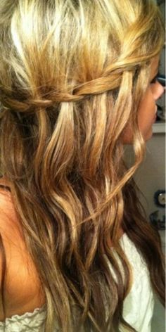 Waterfall braid. Drop 3rd section of hair (on on bottom) and take a new section (from the bottom) and continue, repeating dropping the 3rd section every time.Takes practice.