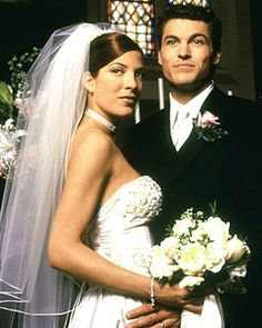 """Here's an old one, way back to the first season of Tori Spelling Spelling's Donna Martin began dating David Silver (Brian Austin Green) in high school on Beverly Hills, The characters tied the knot in 2000 in an episode titled """"Ode to Joy. Beverly Hills 90210, Celebrity Wedding Gowns, Brian Austin Green, Wedding Movies, Hollywood Wedding, Movie Couples, Power Couples, Celebs, Celebrities"""