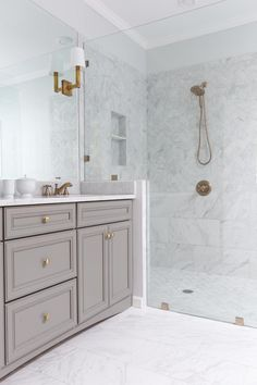 Marble Bathroom with Brass Fixtures HGTV Herb: is this how you envision the cabinetry meeting the shower?
