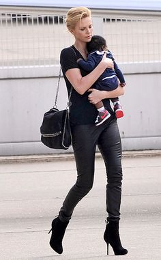 The new mom keeps her kid close as she boards a private jet in London.