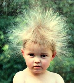 This is what Jon Jon's hair looks like after he comes out of hiding behind my living room drapes...hilarious!