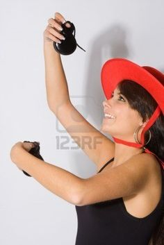 Cheerful Spanish flamenco dancer with castanets.